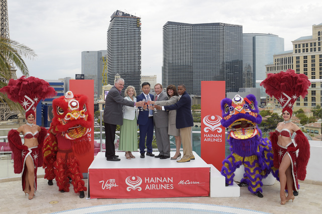 From left, Clark County Commissioner Steve Sisolak, Congresswoman Dina Titus, D-Nev., Hainan Vice President Hou Wei, LVCVA President and CEO Rossi Ralenkotter, McCarran International Airport Direc ...