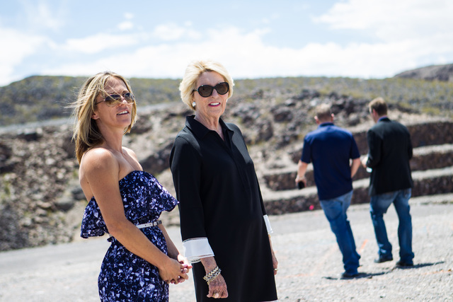 Chase Stevens/Las Vegas Review-Journal Kristi Palmer, left, with Florence Shapiro, survey the land at the groundbreaking of Palmer's new home to be built in Ascaya, a luxury home development in He ...