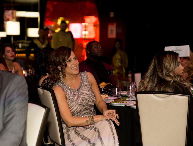 TONYA HARVEY/LAS VEGAS BUSINESS PRESS The 2017 president of the Las Vegas chapter of the National Association of Hispanic Real Estate Professionals, Fritzi Ortiz, watches the Dec. 3 awards ceremon ...