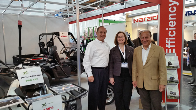 Xtreme Green Electric Vehicles COO Neil S. Roth, Deputy Director General of the U.S. and Foreign Commercial Service Judy Rising Reinke, and Xtreme Green Electric Vehicles CEO Byron Georgiou attend ...