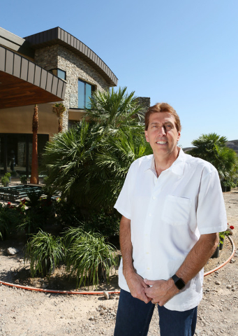 Daniel Coletti, president of Sun West Custom Homes, stands outside an under-construction luxury home Tuesday, June 2, 2015, in Henderson. The 12,000-square-foot custom-built home, is located in th ...