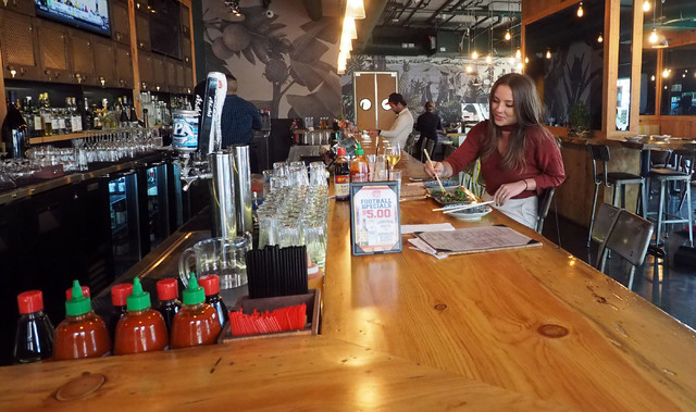 Ashlee Beckwith of Las Vegas enjoys lunch at Le Pho at The Promenade at Juhl. KRE Capital plans to bring the rental units in the high-rise to the market in 2017. (Jerry Henkel/Las Vegas Business P ...