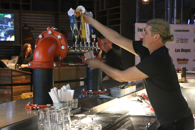 President and Managing Partner of Nacho Daddy Paul Hymas pours drinks behind the bar during the company's Strip restaurant's Aug. 17 grand opening. (Courtesy of Nacho Daddy)