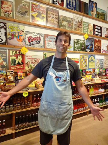 Damian Barton, owner of Rocket Fizz Las Vegas in the Village Square shopping center at Sahara and Fort Apache, poses in front of his massive assortment of soda pop and pop art. (Craig A. Ruark, Sp ...