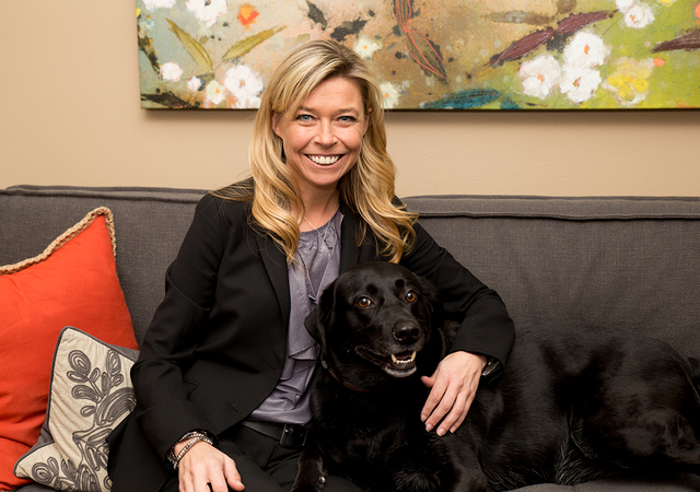 Family law attorney Corinne Price shares her office with a rescued Labrador named Dolly, who helps her child clients feel more at home. (TONYA HARVEY/LAS VEGAS BUSINESS PRESS)