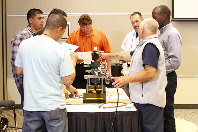 Refrigeration workers take part in an educational session at a recent RETA conference. (Courtesy RETA)