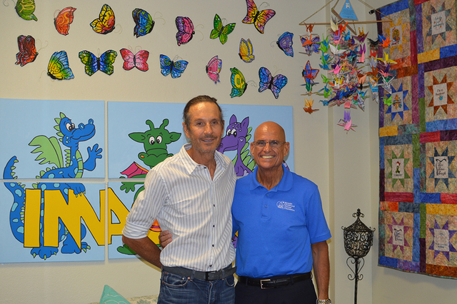 COURTESY From left, Las Vegas land developer Brett Torino and CEO of Nevada Childhood Cancer Foundation Jeff Gordon talk about Torino Ranch and other programs offered through the local charity.