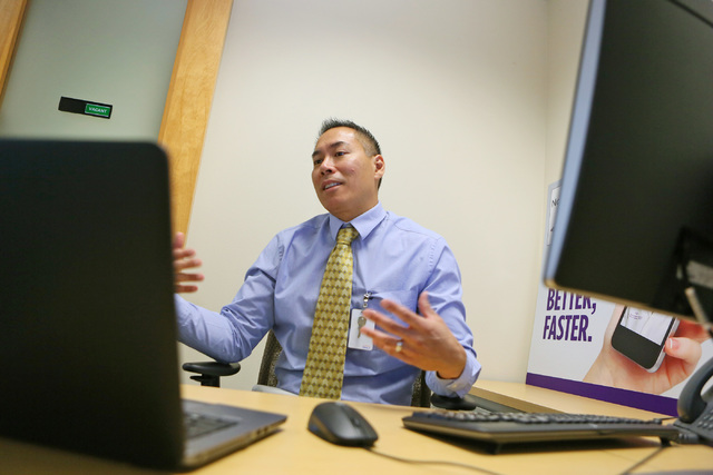 Dr. Eugene Somphone sits down with the Business Press to discuss Southwest Medical's NowClinic secure virtual appointment system. (Ronda Churchill/Las Vegas Review-Journal)