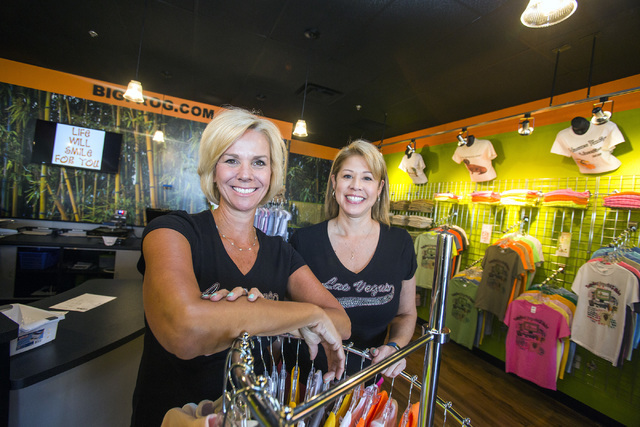 Robyn Brewington, left, and Lisa Hughes opened Big Frog's 72nd location last month. The women purchased the franchise rights from the Florida-based company that specializes in full color, printed  ...