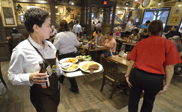 Sarai Rosa, left, takes food to a table at Cracker Barrel at 8350 Dean Martin Drive in Las Vegas. (Bill Hughes/Las Vegas Business Press)
