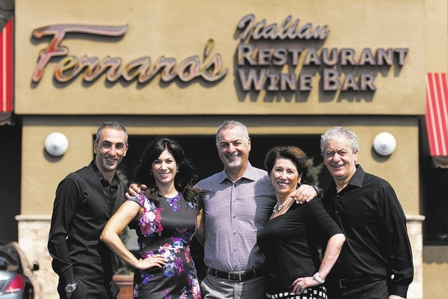 (Jason Ogulnik/Las Vegas Business Press) The family that runs Ferraro's Italian Restaurant & Wine Bar stands outside of their Las Vegas restaurant Aug. 25. Pictured from left: Walter Ferraro,  ...