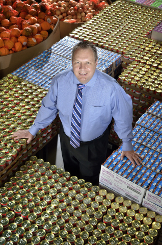 Dan Williams, chief operating officer at Three Square Food Bank, is shown in the organization's warehouse at 4190 N. Pecos Road July 19. (Bill Hughes/Las Vegas Business Press)