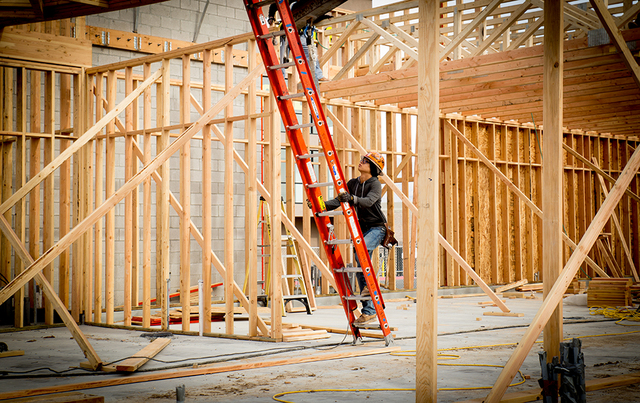 A worker climbs Las Vegas-based NDL Group Inc. job site. The recent spike in commercial and homebuilding construciton has created a labor shortage. (Tonya Harvey/Las Vegas Business Press)