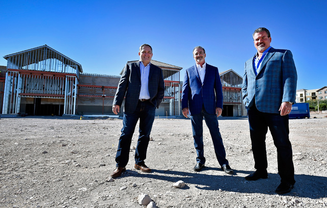 David Becker/Las Vegas Business Press Partners at Remington Nevada, from left, Tom Fehrman, Stan Wasserkrug and Remington Nevada president and founder David DelZotto stand at Mountain Edge Marketp ...
