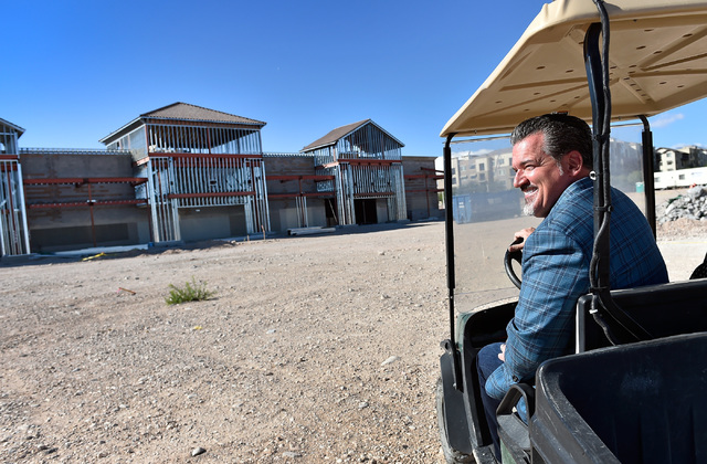 David Becker/Las Vegas Business Press Developer David DelZotto, founder and president of Remington Nevada, oversees his project, Mountain Edge Marketplace. The 185,000 square-foot center at the so ...