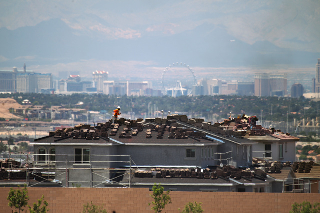 Workers are seen on the roof of an under-construction house in the Cadence, a master-planned community in Henderson. (Sam Morris/Las Vegas Business Press)