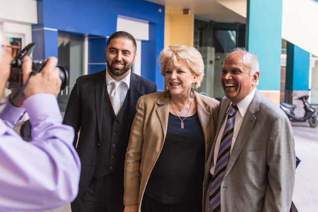 Minister and Little Neon Chapel owner Ben Silvano, left, poses for a photo with Mayor Carolyn Goodman, center and Rohit Joshi during the Chapel's grand opening at Neonpolis July 5. (Elizabeth Brum ...