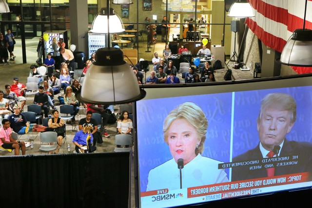 People watch a live broadcast of the third 2016 presidential debate at College of Southern Nevada North Las Vegas campus Oct. 19. (Ronda Churchill/Las Vegas Business Press)
