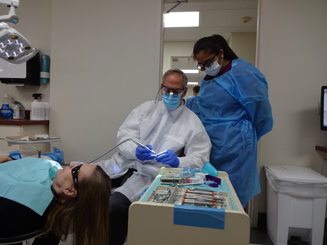 Dr. Philip Devore, DDS, associate professor at UNLV's School of Dental Medicine works with student Kristine San Diego on a patient at the school's UNLV Dental Clinic. (Craig Ruark/Las Vegas Busine ...