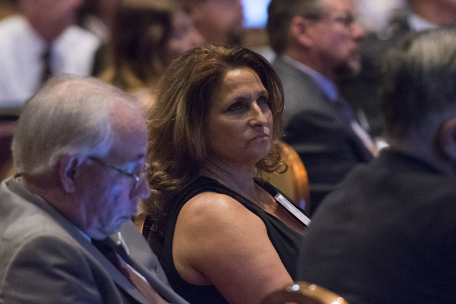 Loretta Moses, executive director of the Clark County Medical Society, listens to doctors and lawmakers talk about the state's prescription drug abuse problem at a recent summit. (Jason Ogulnik/La ...