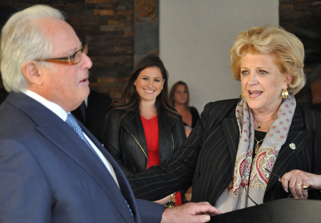 Buford Davis/Las Vegas Business Press Mayor Caroline Goodman greets El Cortez owner Kenny Epstein during a 75th anniversary celebration in November. Alex Epstein, center, looks on.