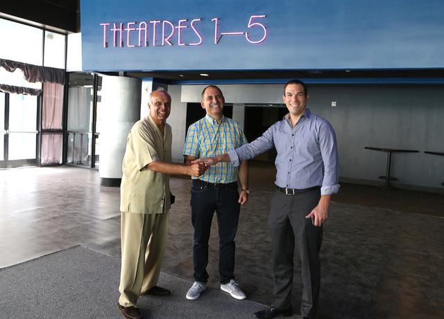 Alex Igelman, CEO, Millennial Esports, center, Rohit Joshi, left, and Las vegas attorney, Ofir Ventura pose for a photo inside Neonopolis' movie theater on Fremont St. on  Sep. 1. (Bizuayehu Tesfa ...
