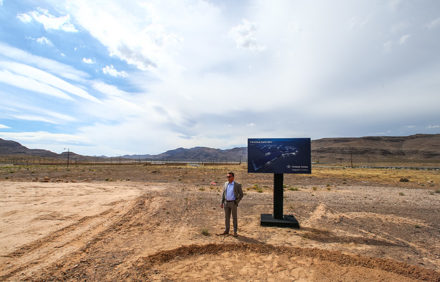 Faraday Future Vice President of Manufacturing Dag Reckhorn waits for others during the groundbreaking for the company's planned 900-acre manufacturing site in North Las Vegas on April 13. (Chase  ...