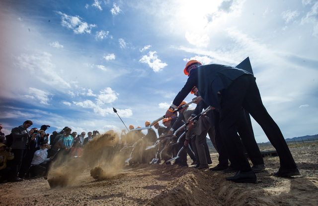 Chase Stevens/Las Vegas Business Press Government and Faraday Future officials shovel dirt during the groundbreaking for the company's planned 900-acre manufacturing site in North Las Vegas April 13.