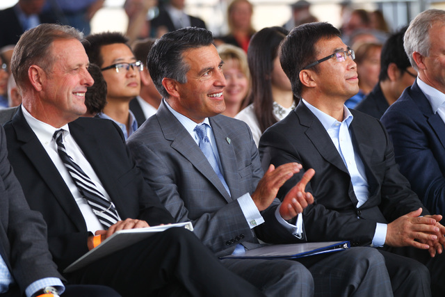 From left, North Las Vegas Mayor John Lee, Gov. Brian Sandoval and Ding Lei, co-founder and global vice chairman of SEE Plan, listen during the groundbreaking for Faraday Future's planned 900-acre ...