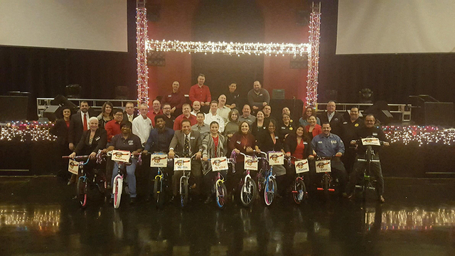 Fiesta Rancho team members assembled bikes for students at Ollie Detwiler Elementary School Dec. 9. (Courtesy)