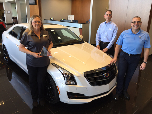 Findlay Cadillac sales consultant Deb Topham, recently named the top salesperson for Cadillac stores in Nevada, is seen with Cadillac district sales manager Ronald McTavish and Findlay Cadillac ge ...