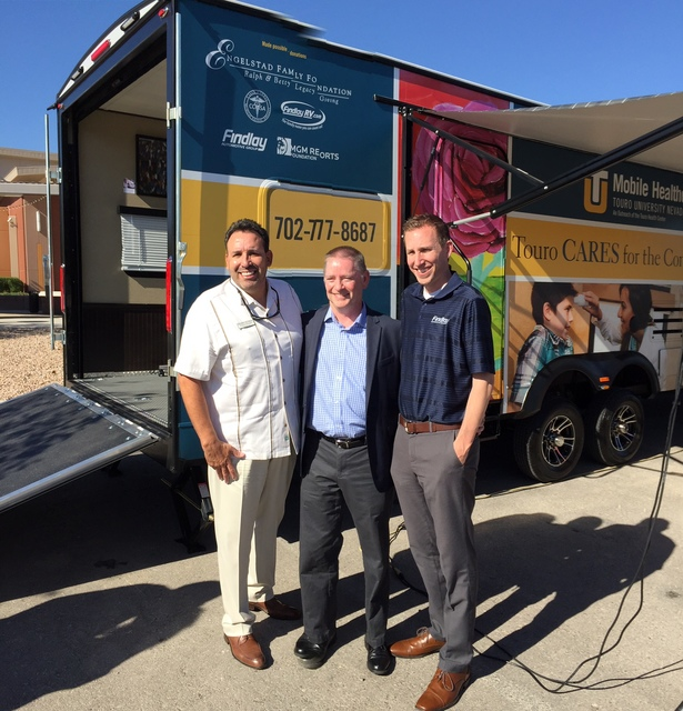 COURTESY Findlay Automotive CFO Tyler Corder, center, is flanked by Findlay RV general manager Reuben Figueroa, left, and E-commerce Director Jeff Giles at the unveiling of the second Touro Univer ...