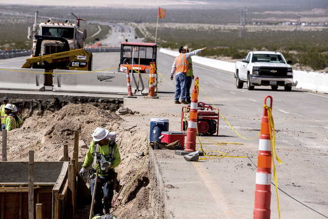 Men work on the Interstate-11 Boulder City Bypass overpass under construction at U.S. 95 on Monday, July 18, 2016.The 12.5 miles of freeway is scheduled to open in late 2018. Jeff Scheid/Las Vegas ...