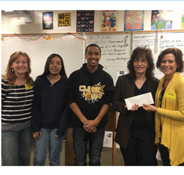 Henderson GiVe founder, Leslie DeVore (right) presents the group's Golden Give to Clark High School teacher Luane Wagner (second from right). They are joined by (from left) GiVe member Cyndy Mahon ...