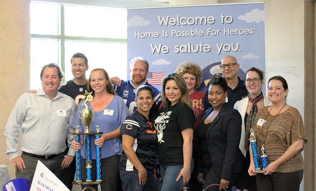 Nevada Housing Division honored Southern Nevada loan officers and lenders in seven categories at a special sports-themed luncheon held at the Spring Preserve Oct. 20. Holding the large trophy is 2 ...