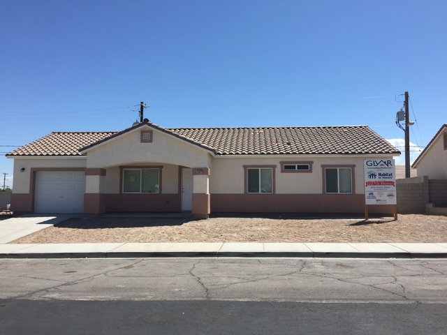 In partnership with Habitat for Humanity Las Vegas, the Greater Las Vegas Association of Realtors dedicated a Habitat house for a local working family. (Courtesy)