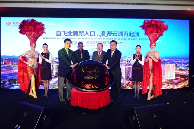 COURTESY Hainan Airlines Vice President of Marketing Hou Wei, Clark County Commissioner Lawrence Weekly, Las Vegas Convention and Visitors Authority President Rossi Ralenkotter and World Tourism C ...