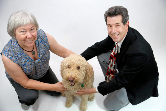 Jeff Saffer and Vicki Burnett, founders of Quertle Industry, a Henderson biomedical big data analytics company, with their dog, Nutmeg. (Courtesy)