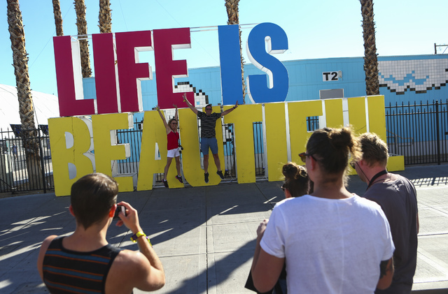 Chase Stevens/Las Vegas Business Press Attendees pose for a photo during the Life is Beautiful music and arts festival in downtown Las Vegas Sept. 23.
