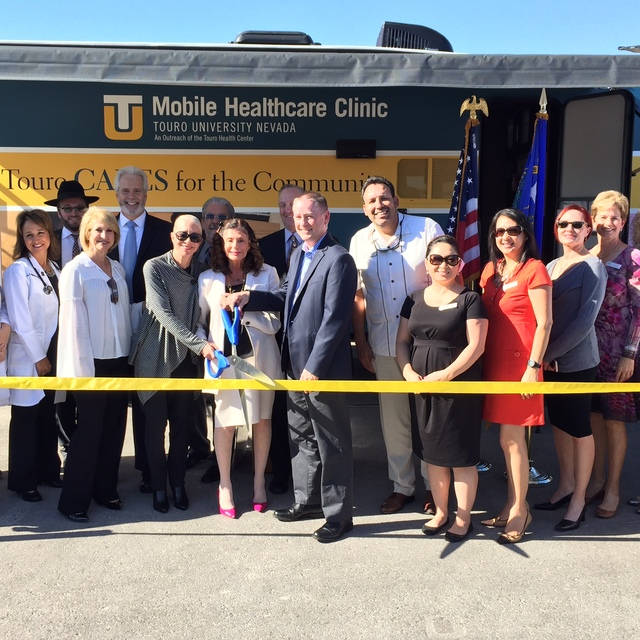 COURTESY Touro University CEO Shelley Berkley, center, cuts the ribbon for the second Touro University Nevada Mobile Health Care Clinic with Shelley Gitomer, vice president of Philanthropy and Com ...