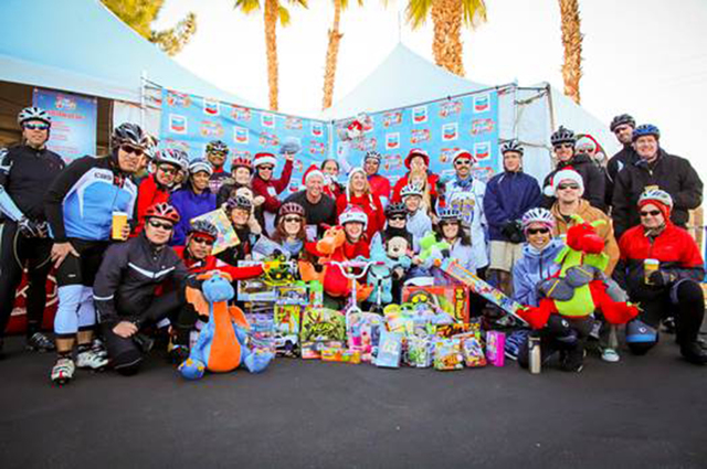 Past years' riders donate toys to Help of Southern Nevada for 98.5 KLUC's Chet Buchanan & The Morning Zoo toy drive. (Courtesy)