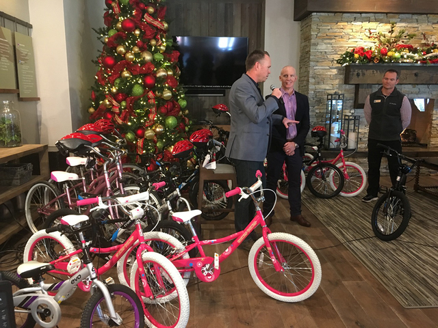 Andy Bischel, president/CEO of the Boys & Girls Clubs of Southern Nevada accepts 100 bicycles from Chris Armstrong, VP of Development at Skye Canyon and 100 helmets from RTC that will go to ch ...