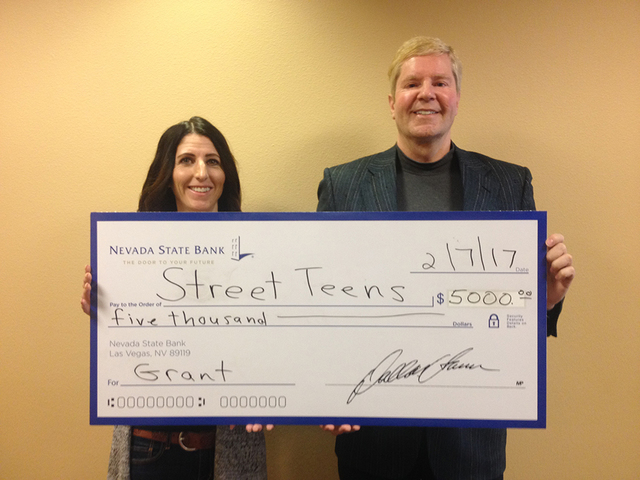Lisa Preston, executive director of Street Teens, with Drew Zidzik, senior vice president, CRA manager for Nevada State Bank. Nevada State Bank presented a check for $5,000 to Street Teens, a volu ...
