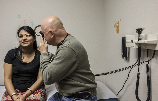 Dr. Michael Nasiak examines Padroni Aggarwal at the UNLV Medicine Ackerman Autism Center. (Benjamin Hager/Las Vegas Review-Journal)