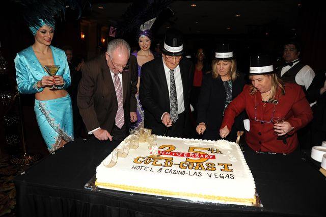 COURTESY From left, former Mayor Oscar Goodman and Boyd Gaming Executive Chairman Bill Boyd, cut a birthday cake in commemoration of the 25th Anniversary of the Gold Coast in December, 2011. Festi ...