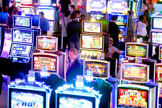People look at themed slot machines in the Scientific Games booth during the Global Gaming Expo at the Las Vegas Sands Expo and Convention Center on Sept. 29. (Jeff Scheid/Las Vegas Business Press)