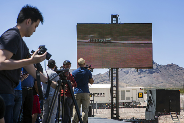 Media and invited guests view a video replay of the Hyperloop One test vehicle propelling down a set of tracks during its first public test at Apex on May 11. (Jeff Scheid/Las Vegas Business Press)