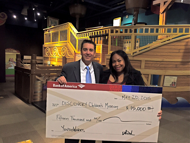 Don Giraldo, Bank of America's Las Vegas market manager, presents one of 16 checks from the B of A's Charitable Foundation to Tifferney White, CEO of Discovery Children's Museum.