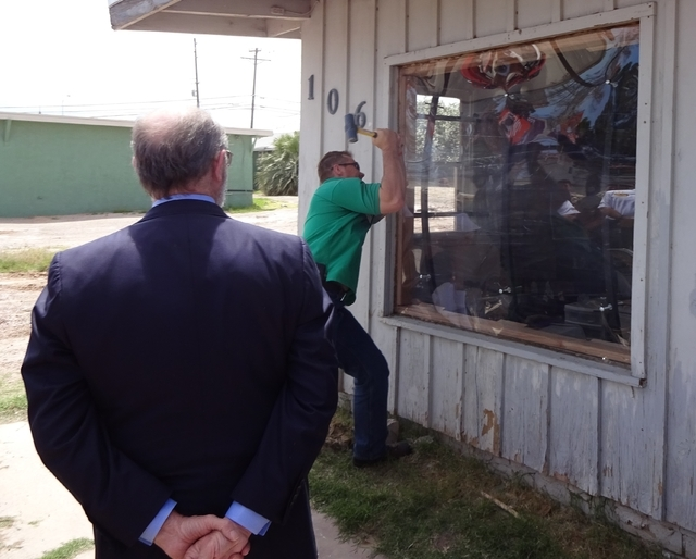 Robert Klein, founder of SecureView, watches a demonstration of the product at an abandoned home near Charleston and Pecos May 5. Craig A. Ruark, special to the Las Vegas Business Press