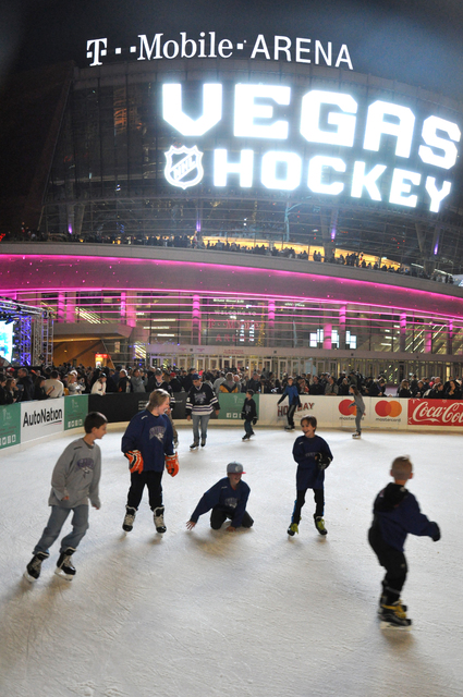 Children skate in front of T-Mobile Arena prior to the unveiling of the city's new NHL franchise name - the Vegas Golden Knights - Nov. 22. Photo by Buford Davis | Business Press